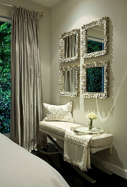 Cushioned white bench and glamorous mirrors; a bench doesn't have to be at the foot of a bed.