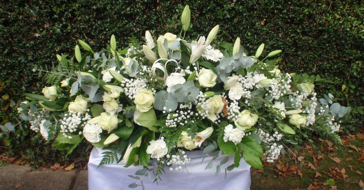 Gorgeous all white coffin spray