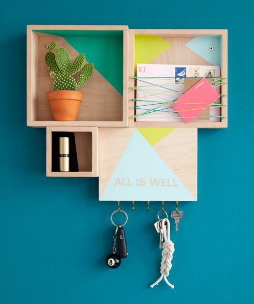 This modular color blocked wall station would be perfect by the front door. It even has a place for keys!
