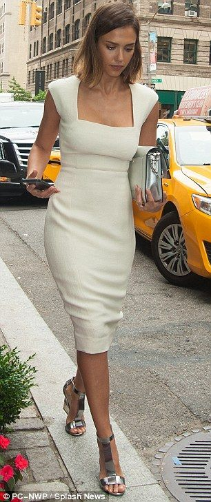 Change of style: Jessica looked chic in a figure-hugging white dress with a square neck an...