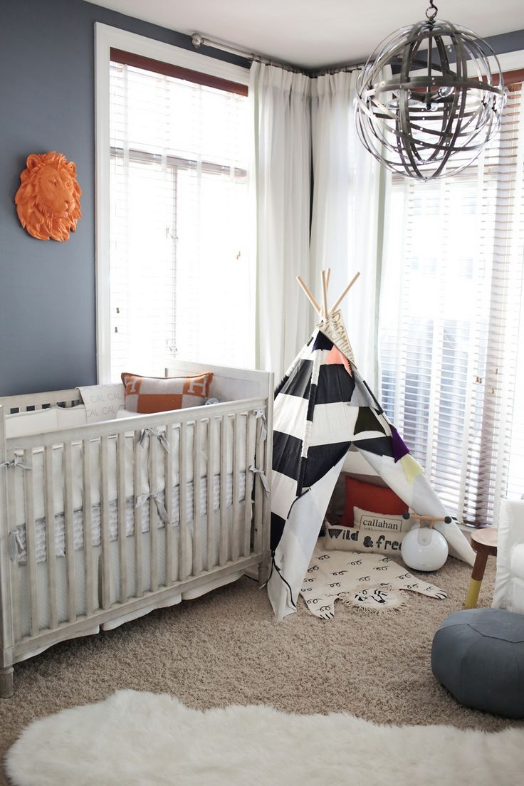 Photography: Allison Kuhn Photography - www.allisonkuhnphotography.com  Read More: http://www.stylemepretty.com/living/2015/04/09/blue-and-orange-adventurous-nursery/