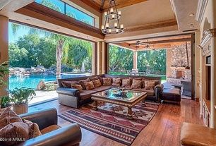 Southwestern Living Room with Nanawall - folding/sliding glass walls, High ceiling, Carpet, Bernhardt Brae Sectional Sofa