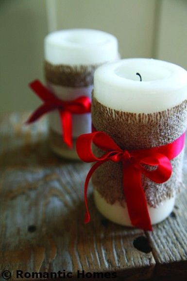 Wrap candles in burlap and red satin ribbon for a...