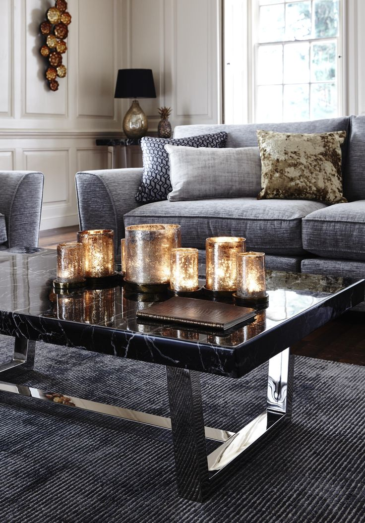 Add a warm glow to your living room with this statement candle holder