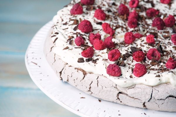 Crunchy meringue on the outer and fudgy inside,  this double chocolate pavlova is delicious with berries and cream.