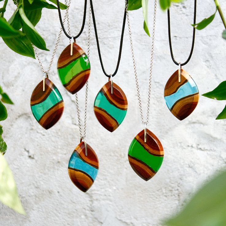 Our eye shaped redwood pendants. These are available in aqua blue, forest green and emerald green.  Free shipping worldwide on all order with more than two items!
