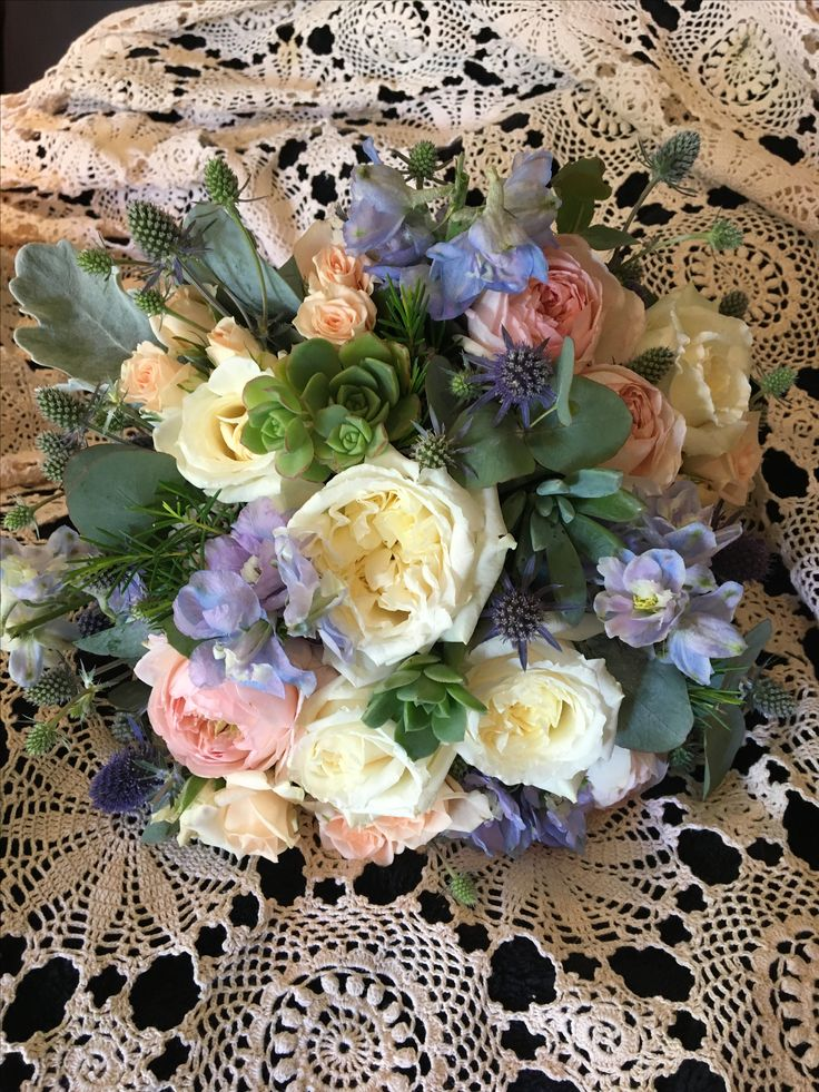 Touch of soft blue , pink and david austen roses @weddingflowersetc