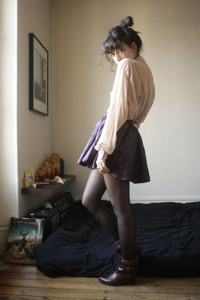slightly puffy shirt, cinched waist, puffy short skirt, lots of leg
