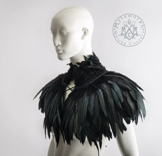 This luxurious feather collar or capelet has four rows of gorgeous iridescent coque feathers, one turned upwards to make the high collar and three