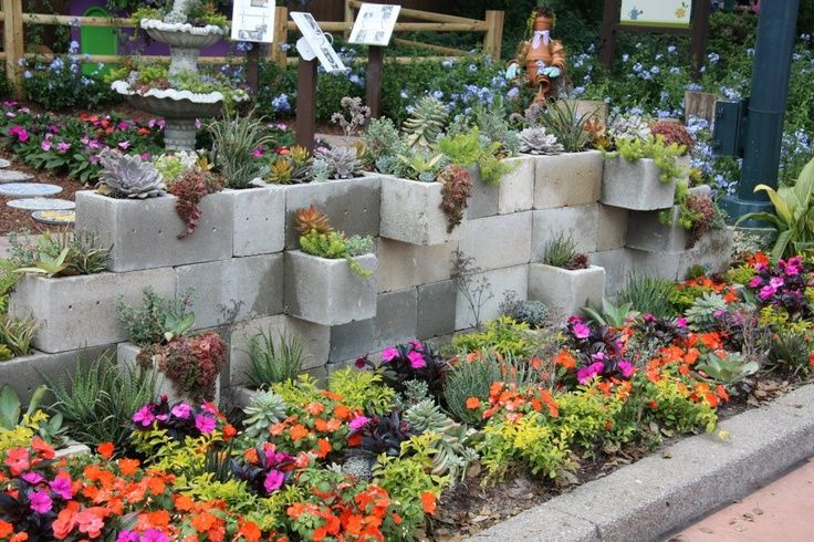 Cinder block wall planted with succulents at Disney's Epcot Center ...