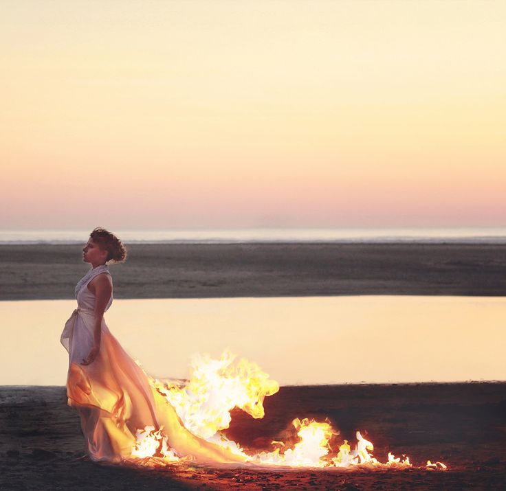.fire a blaze, a band of white sand, she listens to the tide..drinking him in, holding the ghost of his hand...by A.C.A.