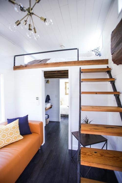 This tiny house includes both a main floor queen bedroom and queen bedroom loft.  Reclaimed wood details throughout.