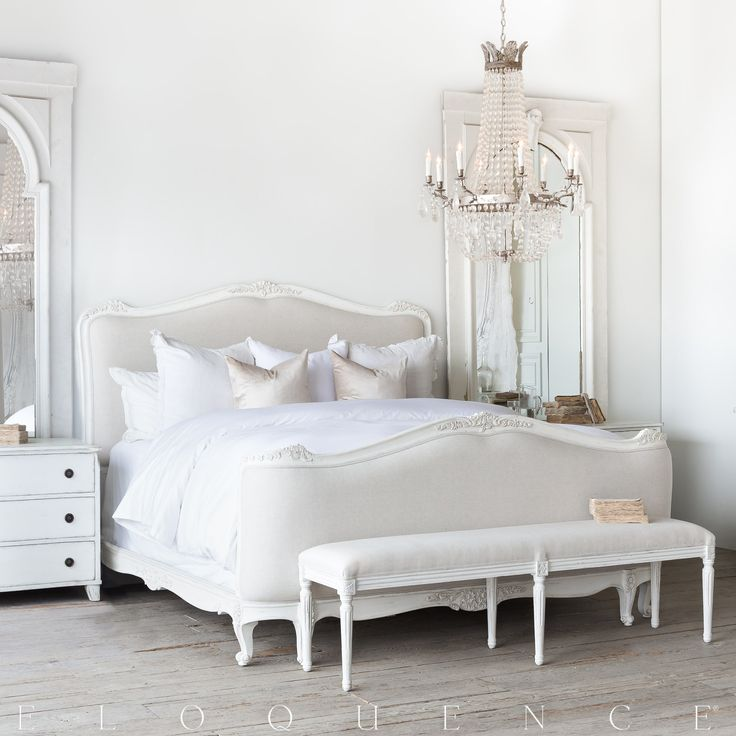 Eloquence® King Sophia Bed, made in the classic Louis XV Corbeille style. Beautifully hand finished in our Antique White and upholstered in Fog Linen fabric. 14 yards to re-upholster. Queen size available as well. Also available in Silver/Antique White Two-Tone, Gold/Taupe Two-Tone, and Weathered White finishes