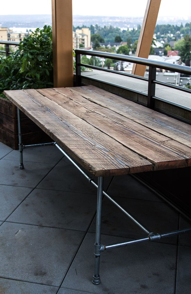 great reclaimed wood table - seems pretty simple, reclaimed wood boards, and galvanize piping base - might look better with black piping.