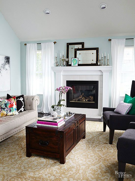 Creative mantel keepsakes color the living room with character.