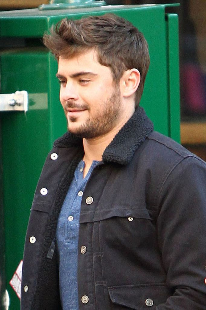 A scruffy and fuller-faced Zac Efron continues to film scenes with co-star Miles Teller for their upcoming movie 'Are We Officially Dating?'