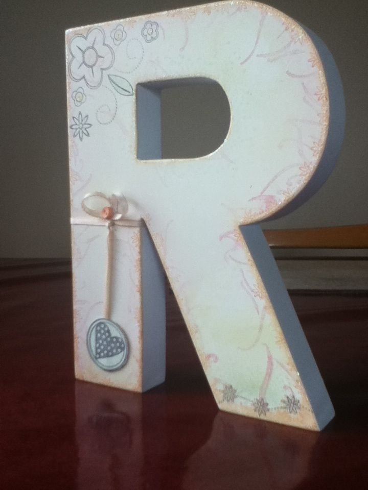 decorated wooden letter