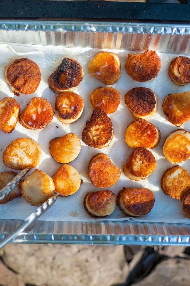"""NYT Cooking: Use large sea scallops, which are often labeled """"u/10"""" or """"u/12,"""" which stands for under 10 or 12 to a pound. And try to get dry scallops as opposed to wet ones, which have been treated with chemicals to extend their shelf life and add moisture. Dry scallops exude much less liquid when cooked and have better texture and flavor. These untreated scallops often tend t..."""
