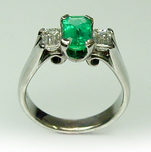 Chibnalls bespoke Ring in 18ct gold witha 1.02ct naturald Emerald matching Emerald cut E VS diamonds totalling 0.74ct. $6500