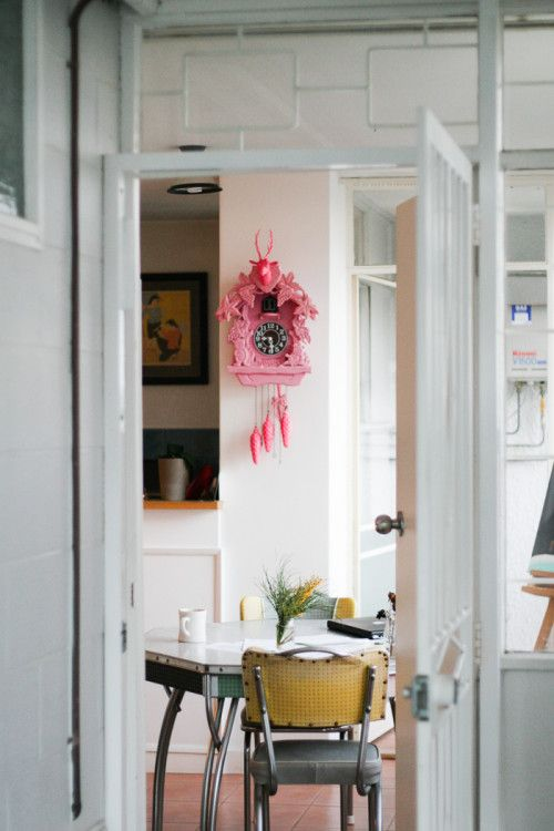 """Sneak Peek: An Eclectic Australian Home Filled With Humor. """"The first thing that you are visually assaulted by when you open the door to my apartment is the bright pink cuckoo clock and the 1950s table that I snagged from a vintage store about 15 years ago. Wherever I go, the table goes. Wherever the cuckoo clock goes, my boyfriend does not. He thinks it's hideous, but I don't take style advice from a guy who wears vertical stripes."""" #sneakpeek"""