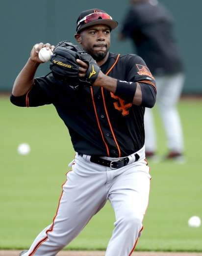 Giants-Dodgers tickets plunge to $6 after brutal start  -  April 24, 2017:     San Francisco Giants' Jimmy Rollins throws during spring training baseball workouts, Friday, Feb. 17, 2017, in Scottsdale, Ariz. (AP Photo/Matt York)