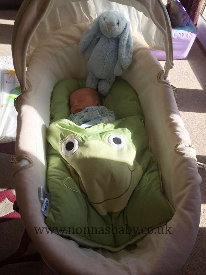 """Lewis is such a cute little man in his Googly Green Nap Mat. Mummy Joanne told us """"This is my son Lewis enjoying his nap mat at just 4 days old. It fits perfectly in his Moses basket and keeps him comfy and cosy for his daytime naps"""". Nonna is delighted! :-) • Find out more about Nap Mats: https://nonnasbaby.co.uk/baby-nap-mats/"""