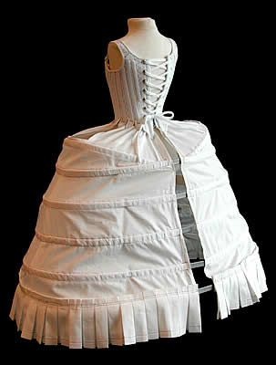 18th century. The hoops were also made of linen and stiffened with whalebone or cane. They shaped the petticoat of the gown to the appropriate silhouette. At various times in the 18th century this profile varied from round, to square and flat, to fan-shaped.: