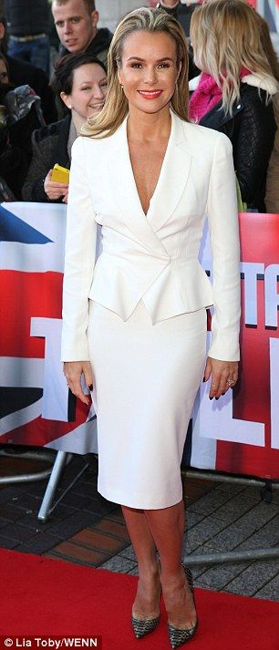 White hot: The blonde star appeared to be wearing nothing under jacket which was cinched in at the waist