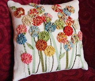 Cute yo-yo flower pillow.