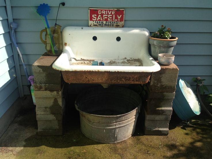 Old enamel sink that I put outside for a potting bench.  I used concrete blocks to to mount it on.  I like it. 7/2013