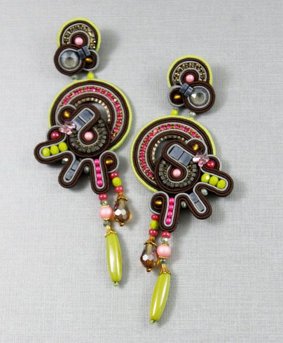 Earrings in the technique of soutache embroidery. Handmade soutache earrings ( stud on ) with Swarovski elements , rhinestones, crystal glass beads, glass beads, tila beads, cube beads, seed beads. Backside is leather. Measures : length 12,5 cm, widest part 4,5 cm. To view the rest of my jewelry creations please visit http://www.etsy.com/shop/BeadsRainbow Thank you for your interest