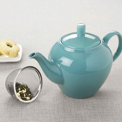 Crafted from ceramic, this beautiful mint blue 'Leaf & Bean Teapot' will bring a smile to any tea lovers face! Shop now through the link in our bio.
