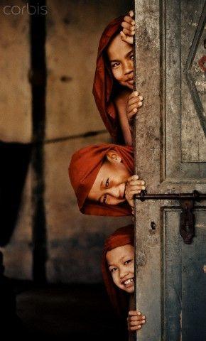 Young monks (8-9, 10-12) standing in doorway, Burma