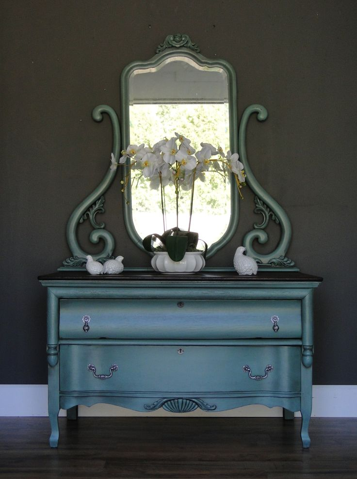 Princess. This lovely and low two drawer dresser has a tall beveled mirror that shows plenty of natural age. Case is painted in muted turquoise and top has gorgeous heavy grain and has been freshly dark stained. Modern Vintage