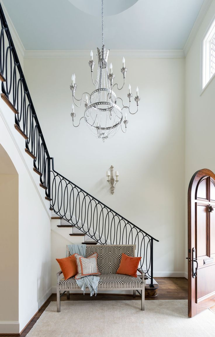 Stairway With Neutral Bench And Orange Accent Pillows Large Gray Chandelier