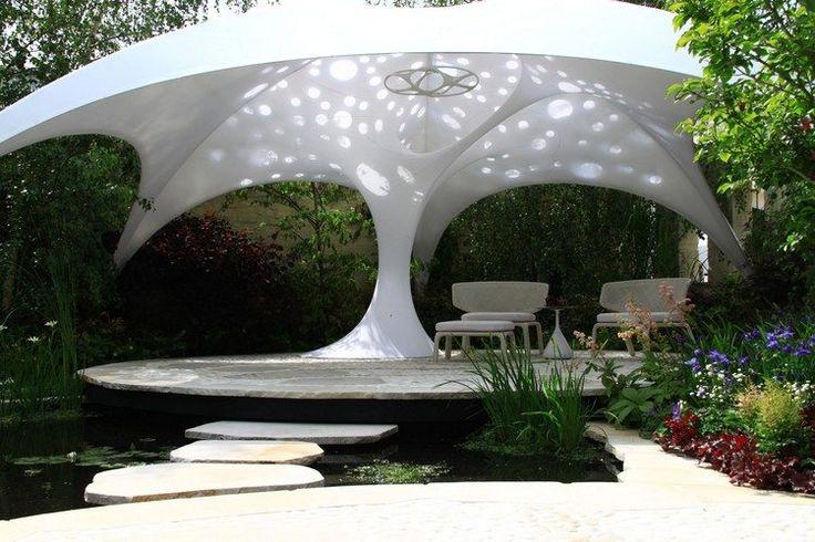 jardin contemporain, terrasse en pierre naturelle, passage à gué en pas japonais et mobilier design