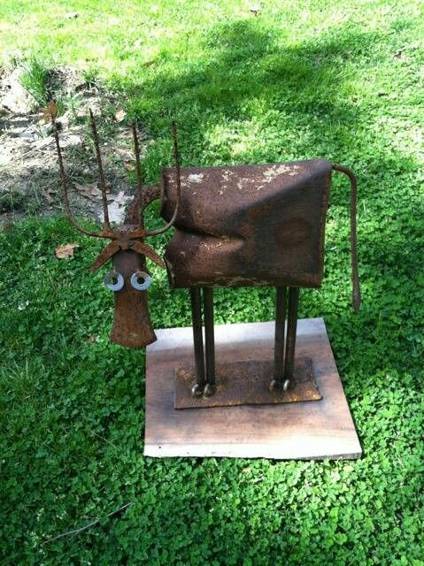 Garden art cow from recycled shovel and other metal pieces