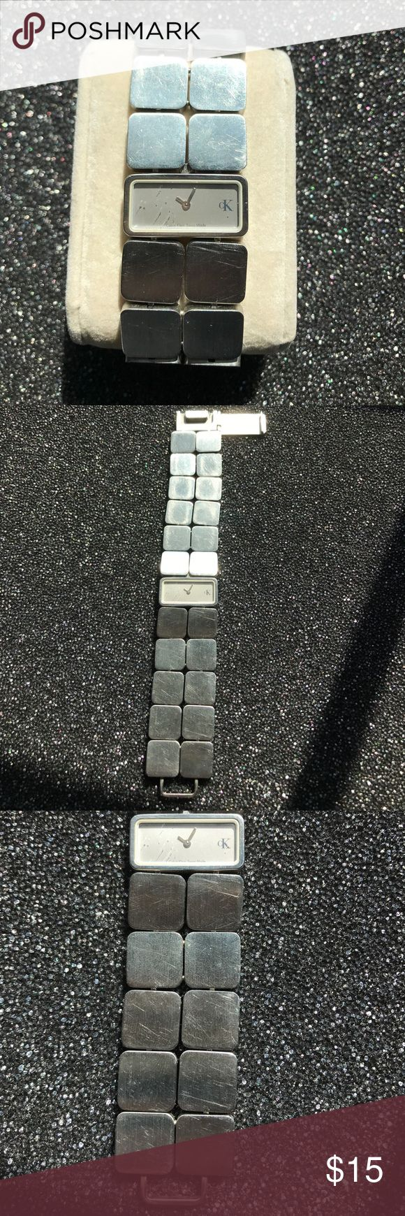 Calvin Klein Bracelet Watch Calvin Klein - Swiss Made - All Stainless Steel - Silver-tone Watch. Model K24131. Water resistant 100 feet. Scratched / worn as pictured. Needs replacement battery. Not currently working. Instruction booklet included. Calvin Klein Accessories Watches