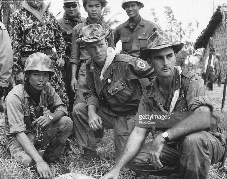 US Army Advisors and Vietnamese troop leaders check the progress of operation Dan Chi, Vietnam, 1964.