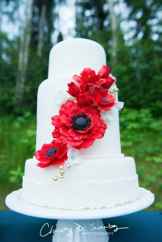 Add bright red poppies to your wedding cake and make it pop! #weddingcake #cake #wedding http://www.weddingchicks.com/2014/07/04/vintage-red-white-blue-styled-wedding-shoot/