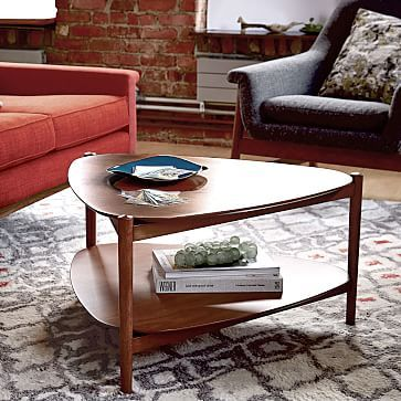 West Elm Retro Tripod Coffee Table  Would look good in the corner with the sofa