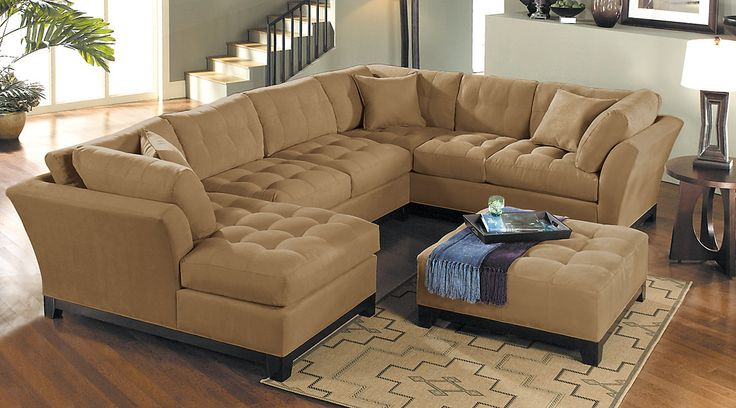 Shop for affordable sectional living room sets at rooms to for Find living room furniture