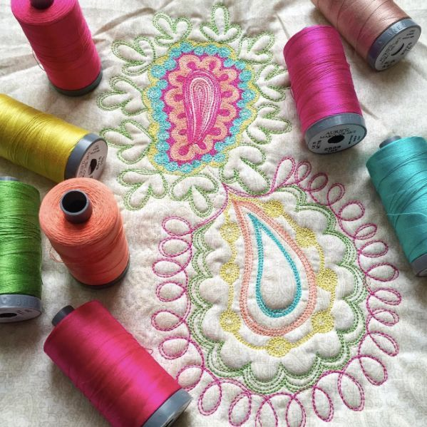 Karen Miller of Redbird Quilt Co. is having some fun experimenting with Aurifil 28wt in her Free Motion Quilting this week! She is using 28wt in the top, 50wt in the bobbin, a 90/14 Top Stitch Needle, & Quilters Dream Batting Wool.   To see what Karen is up to, and follow along with her quilting adventures, check out:  https://www.instagram.com/redbirdquiltco/