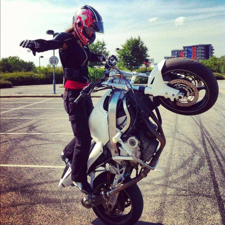 Woman motorcycle stunt rider. Awesomeness. Wish I had the bike and the skills.