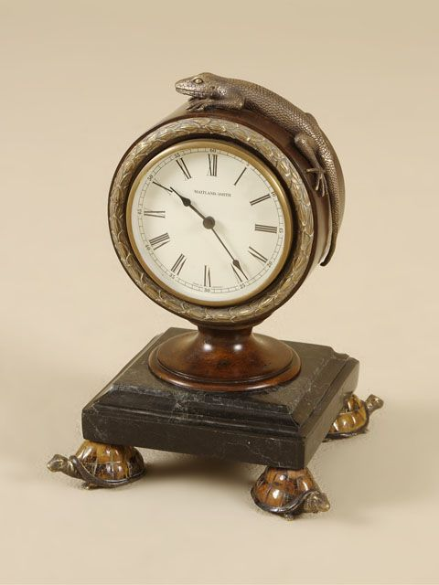 A Lizard And Turtle Supported Feet Add Whimsy To This Small Desk Clock Details That Create
