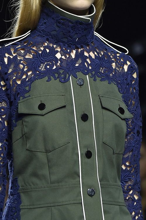 For #SS15 #Sacai merged a hard military look with feminine elements such as delicate lace and ruffles. #PFW