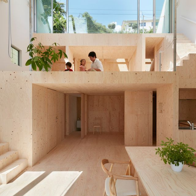 Wide Sloping Roof Shelters Plywood-filled House In Kobe By