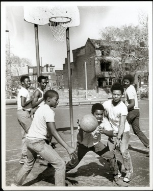 Boys playing informal basketball game. 14 March 1971. Missouri History Museum