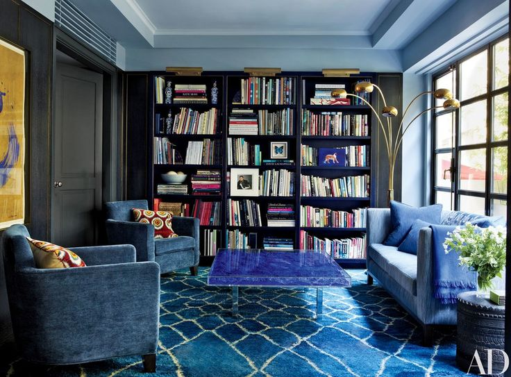 Picture lights like the ones atop the bookshelves in Fiona Kotur's Hong Kong home instantly make us think of grand old libraries. Use them to give simple furniture a sense of importance | archdigest.com