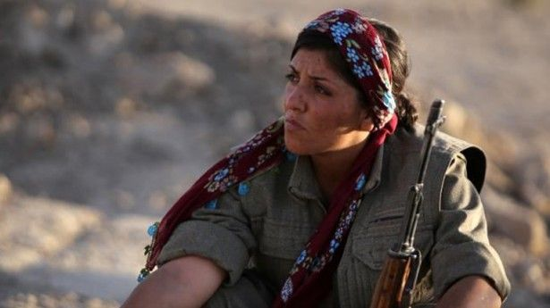 """HEROES: Kurdish female fighters face ISIS jihadists in Iraq's north.  Tekoshin stands on a mountain in north Iraq with a rifle slung over her shoulder and a grenade tucked into her belt, facing jihadists in """"a struggle to liberate women"""".  Women have been fighting alongside men in the Kurdistan Workers' Party to wrest Mount Makhmur in northern Iraq back from Islamic State jihadists, whose treatment of women makes the fight especially personal for the dozens of female fighters on the…"""